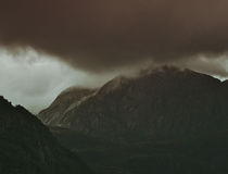 Brown Mountain With Tip Covered by Dark Clouds Royalty Free Stock Photography