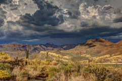Brown Mountains Under Black Clouds Royalty Free Stock Photography