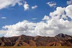 Brown mountains under blue sky. Mountains under blue sky in Gansu,China Stock Photography