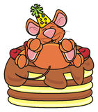 Brown mouse lies on the cake Stock Photography