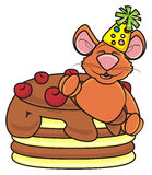 Brown mouse peeking out of the cake Stock Image
