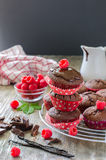 Brown muffins with raspberries vertical image black background Stock Photos