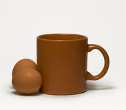 Brown mug on white. Still-life with a brown mug on white Stock Images
