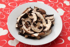 Brown Mushrooms. Some brown raw mushrooms in a bowl stock image