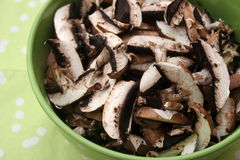 Brown Mushrooms. Some brown raw mushrooms in a bowl stock photography
