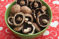 Brown Mushrooms. Some raw brown mushrooms in a bowl stock images
