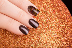 Brown nail polish. Royalty Free Stock Photos