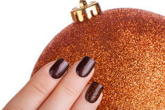 Brown nail polish. Royalty Free Stock Image
