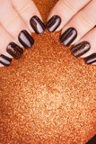 Brown nail polish. Stock Images