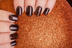 Brown nail polish. Royalty Free Stock Photo