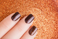Brown nail polish. Stock Photos