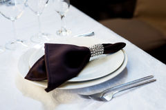 Brown napkin, table settings. Wedding, banquet. Indoor. Brown napkin, table settings. Wedding, banquet Royalty Free Stock Photography