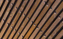 Brown natural background. Wood texture inclined lines perspective perspective vertical metallic rivets industrial. Pattern stock photo