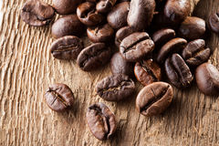 Coffee grains over wooden table Stock Photos