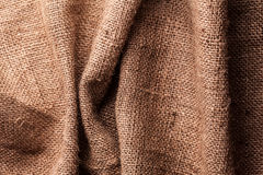 Brown natural linen texture Stock Images