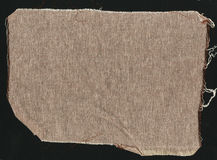 Brown natural simple coarse linen fabric - canvas. Brown burlap fabric background texture. Stock Image