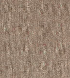 Brown natural simple coarse linen fabric - canvas. Brown burlap fabric background texture. Royalty Free Stock Images