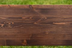 Brown natural wood texture on green background. Zoom photo royalty free stock photography