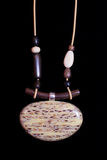 Brown Necklace ethnic jewelry jewelry. On a black background Stock Photos