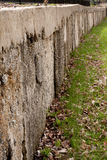 Brown and Neutral Stone Wall Background Texture With Grass Stock Photography