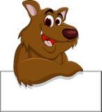 Brown niedźwiedzia kreskówka z puste miejsce znakiem Obraz Stock