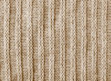 Brown knitwear texture background. Brown knitwear sweater wool texture background macro closeup Royalty Free Stock Photo