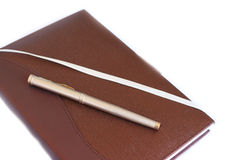 Brown note book and pen Royalty Free Stock Photos