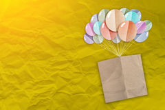 Brown note paper with balloons shape paper cut Royalty Free Stock Photo