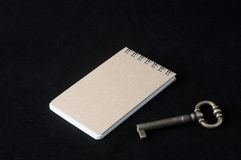 Brown note paper with key Royalty Free Stock Image