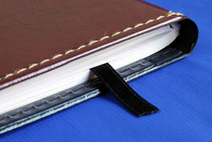 Brown notebook with a black bookmark Royalty Free Stock Photography