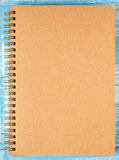 Brown notebook on blue wooden. Stock Photos