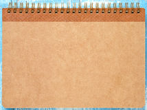 Brown notebook on blue wooden. Stock Image