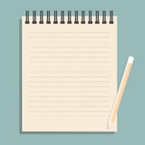 Brown notebook with dotted lines can shred and pencil. Royalty Free Stock Photography