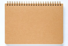 Brown notebook paper on white background. Royalty Free Stock Photos
