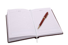 Brown notebook and pen Royalty Free Stock Photos