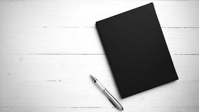 Brown notebook and pen black and white tone color style Royalty Free Stock Photography