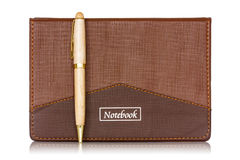 Brown notebook and pen Stock Image