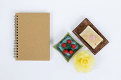 Brown notebook with spa decorate and natural soap bar with incense cone Royalty Free Stock Images