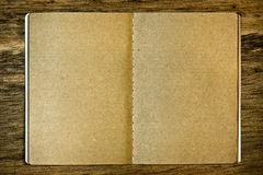 Brown notepad on the wood background Royalty Free Stock Images