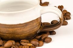 Brown Nuts and Brown Ceramic Tea Cup royalty free stock photo