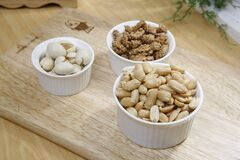 Brown Nuts on White Ceramic Bowl Royalty Free Stock Image