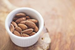 Brown Nuts in White Ceramic Bowl Stock Photos