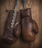 Brown old boxing gloves Stock Photography