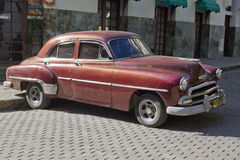 Brown old classic cuban car. Brown old classic car in a street in Havana. Past international embargoes have meant Cuba has maintained many pre-revolutions Royalty Free Stock Image