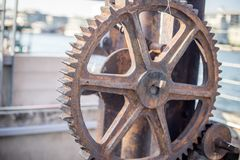 Brown old metal wheel near bay royalty free stock images