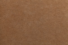 Brown old paper background. Thick cardboard. Stock Images