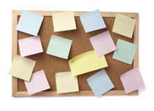 Brown old paper note background cork board. Collection of various note papers  on cork board, on white background with clipping path Stock Photo