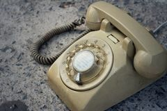 Brown old phone vintage style on a floor. Stock Photography
