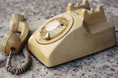 Brown old phone vintage style on a floor. Stock Photos