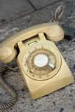 Brown old phone vintage style on a floor. Royalty Free Stock Images